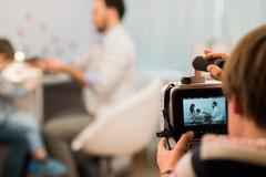 Professional video camera or camcorder recording stock footage medical theme Kuvituskuvat