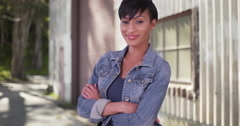 Confident millennial woman with arms crossed wearing jean jacket Stock Footage