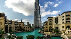 Timelapse of floating clouds above Burj Khalifa, Dubai, UAE Stock Footage