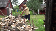 Strong villager boy prepare natural wood fuel and rural houses. 4K Stock Footage