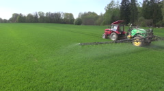 Tractor spraying fields with pesticides on sunny day Stock Footage