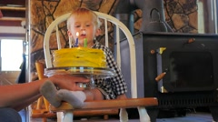 2 year old blowing out candles on a birthday cake - stock footage