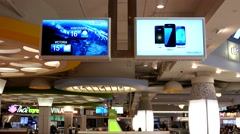 The weather network on tv inside food court at Burnaby shopping mall Stock Footage