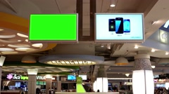 The commercial ad on tv with green screen tv inside food court Stock Footage