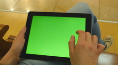 Female hands using tablet pc with green screen. Chroma key - stock footage