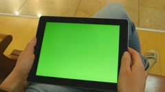 Female hands using tablet pc with green screen. Chroma key Stock Footage