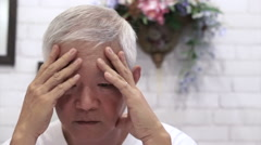 Video of Asian senior guy with hand on face thinking, worry and sad Stock Footage