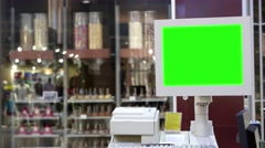 Green billboard for your ad at computer screen inside shopping mall - stock footage