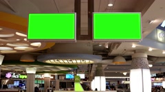 Green billboard for your ad at tv inside food court at Burnaby shopping mall - stock footage