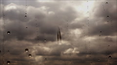 Storm clouds flying fast through the rainy window, close up view Stock Footage