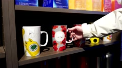 Woman buying mug inside Starbuck store Stock Footage