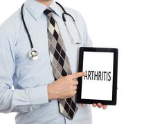 Doctor holding tablet - Arthritis - stock photo