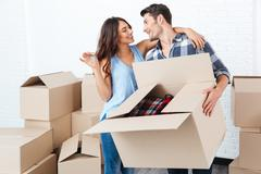 Couple showing keys to new home - stock photo