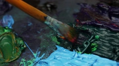 Extreme close-up of an artist brush painting with oil paints. Palette Stock Footage