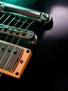 Electric guitar strings and bridge closeup - stock photo