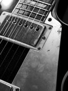 Macro electric guitar strings and pickups Stock Photos