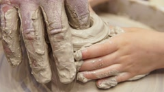 Close-up of man's hands, teach the child the art of pottery Stock Footage