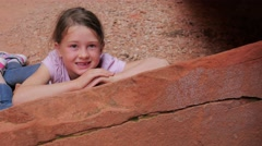 Little girl camping looking at the camera Stock Footage