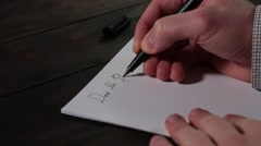Stock Footage SnCaucasian male hands writing Dear Mr. President Stock Footage