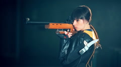 Girl shooting from a rifle - stock footage
