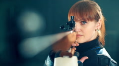 Woman training sport shooting with air rifle gun Stock Footage