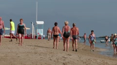 Seniors OId People Elderly Tourists Walking On Beach Near Sea - stock footage