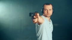 Man shooting with gun at a target - stock footage