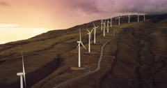 Aerial view of windmills turning at sunset Stock Footage