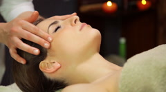 Woman getting head and face massage in spa Stock Footage