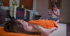 Thanking before doing a foot massage Stock Footage