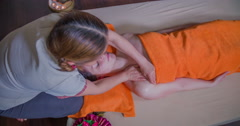 Massaging her chest and upper body - stock footage