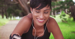 Athletic healthy black woman runner resting during jog on outdoor trail Stock Footage