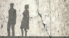Shadows of a woman and man on the wall Stock Footage