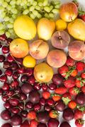 Fresh mixed fruits, berries background.Healthy eating.Love fruit, diet. - stock photo
