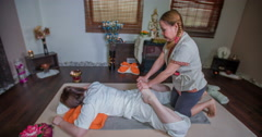 Masseur is massaging the guests legs and a bum - stock footage