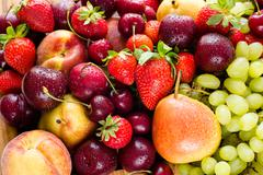 Fresh mixed fruits, berries background.Healthy eating.Love fruit, diet. Kuvituskuvat
