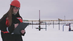 Multiscreen. Female engineer and oil man working together in an oilfield Stock Footage