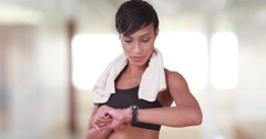 Black woman in gym using smart watch to check heart rate - stock footage
