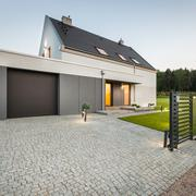 Design house with stone driveway - stock photo