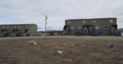 Pan of houses in Pond Inlet in Nunavut Stock Footage