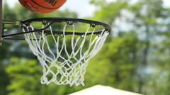 Children throw the ball into basketball hoop - active playing sport game kids - stock footage