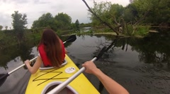 Two people canoeing in the river in slow motion Stock Footage
