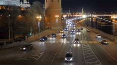 night car traffic near Kremlin, boat is moving on Moscow river - stock footage