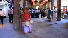 People perform traditional music at the Temple of Tooth in Kandy, Sri Lanka Stock Footage