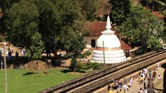 People walk by the territory of the Temple of Tooth in Kandy, Sri Lanka. Stock Footage