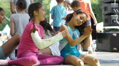 Happy little kid girls dancers behing the scenes having fun dancing warming-up Stock Footage