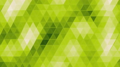Smooth waving loop of glassy yellow green polygons. - stock footage