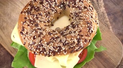 Rotating Bagel with Cheese (not loopable; 4K) Stock Footage