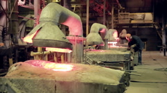Metallurgical works, molten metall production at foundry factory Stock Footage