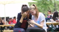 Teen age young girls using smart phone typing chatting in social media chatting Footage